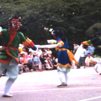 Andrew (left) dancing Korean mask dance, 1999