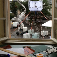 Bryan and Ian building their lantern clock tower in the rain. Meanwhile, we cut paper puppets inside.