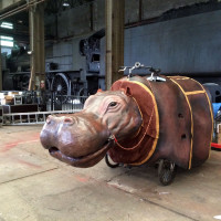 Hippo prepares for his French fans. Check out the giant train in the back which is entirely MADE OF WOOD!