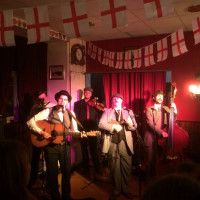 Sound of old timey Americana (Dr. Butler's Hatstand Medicine Band) in a fake English pub in France--wait, where am I?