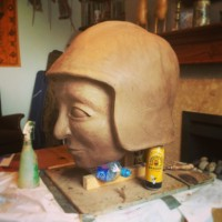 Head sculpted. Beer cans just the right height to prop clay!